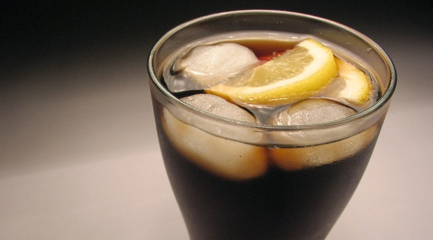 Glass of soda with lemon